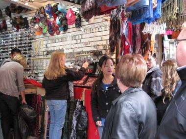 Chinatown hawkers line a crowded Canal Street selling goods to shoppers and tourists. A new law proposed by Councilwoman Margaret Chin would punish buyers of knockoff designer bags.
