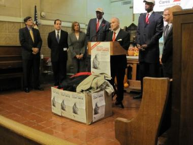 New York Police Department Commissioner Raymond Kelly, flanked by retired NBA stars Bob Lanier and Dikembe Mutombo and other officials, speaks at a news conference announcing the start of the 21st annual New York Cares Coat Drive, at the Bowery Mission on Dec. 1, 2009.