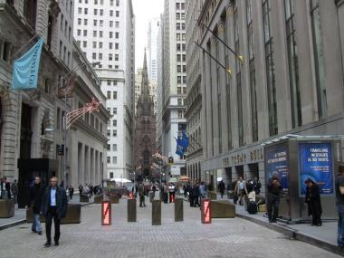 The city improved the security barriers on Wall St. last year, but they still block off public space.