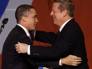 Former Vice President Al Gore embraces former Rep. Harold Ford Jr., left, after Ford introduced Gore at the annual Jackson Day Democratic fundraising dinner in Nashville, Tenn., Saturday, Aug. 29, 2009.