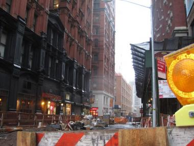 The Office of Emergency Management advised Lower Manhattan residents to remain indoors after debris began falling from a 77-story construction site Monday.