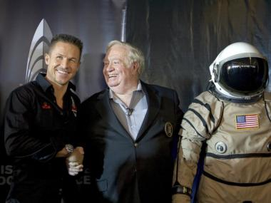 Test jump pilot Felix Baumgartner, who will attempt to break the speed of sound in a free-fall from space, shakes hands with space-jumping mentor and coach Joe Kittinger.