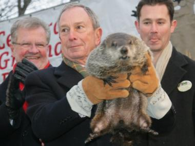 Mayor Michael Bloomberg holds up S.I. Chuck, who predicted an early spring in 2010.