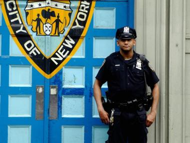 A police officer stands outside the 1st Precinct in TriBeCa