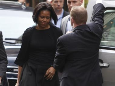 First Lady Michelle Obama enters her car during a visit to New York, Sunday, March 21, 2010.