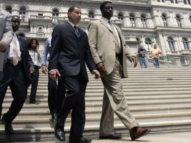 Gov. David Paterson, left, and aide David Johnson walk down the steps of the Capitol in Albany.