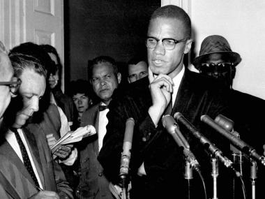 Malcolm X talking to reporters in 1963, two years before his death.