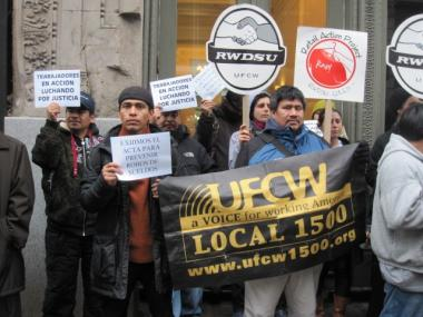 A group gathered outside Scoop NYC to support a new bill against wage theft.