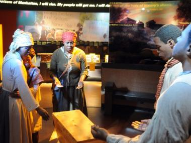 Life-sized figures illustrate a burial ceremony at the African Burial Ground's small visitors center, which opened in 2010.