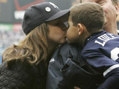 Melanie Lidle (l.) kisses her son Christopher before the pair each threw out a ceremonial first pitch in the Yankees season-opening baseball game on April 2, 2007.
