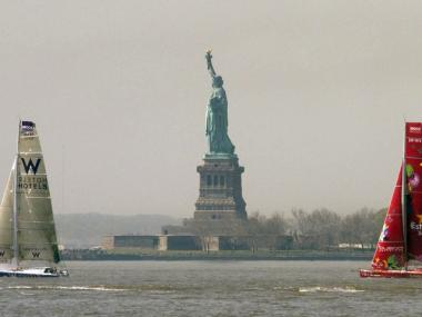 The W Hotel and the Estrella Damm leave the Statue of Liberty in their wake heading for Barcelona.