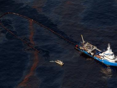 A boat works to collect oil leaking from an underwater wellhead in the Gulf of Mexico following a BP oil rig explosion Apr. 20, 2010.