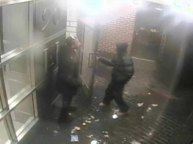 Two male suspects are seen here on security camera videotape outside of a building.