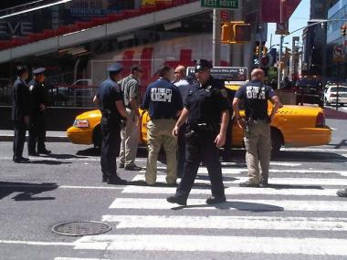 A taxi tries to drive through a road block in Times Square after it was evacuated on May 7, 2010.