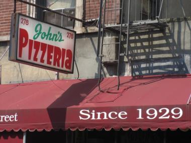 John's slice originated in Port Alba, Italy, and makes use of a thin crust, brick-oven style of pizza with shredded mozzarella.