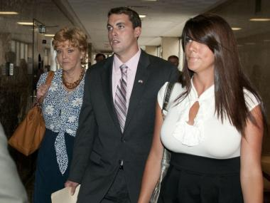 Former New York City police officer, Patrick Pogan, 24, arrives for sentencing Wednesday with his mother and girlfriend.