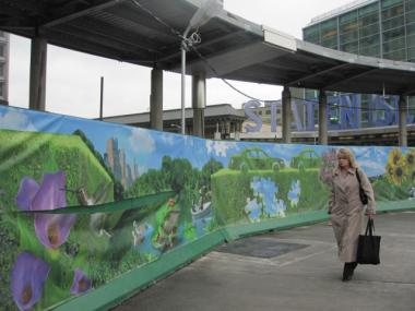 One of three slashed panels of a new mural outside the Whitehall Ferry Terminal.