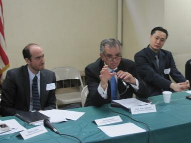 U.S. Department of Transportation Secretary Ray LaHood (center), surrounded by Chinatown Working Group co-chairmen Jim Solomon (l.) and Thomas Yu (r.).