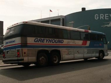 A Greyhound bus waits at a light outside the Greyhound Bus Terminal in New York.