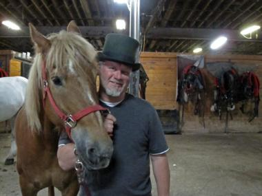 Carriage rider Colm Glennon poses with his horse Roger at the Shamrock Stables on West 45th Street on May 18, 2010. Glennon is one of 25 stable employees who will have to get new work if the stable cannot find a new home by June 1st.