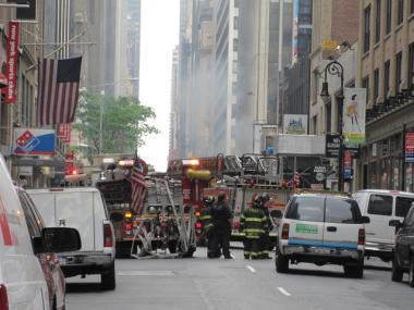 FDNY crews worked to douse a manhole fire that erupted near Times Square.