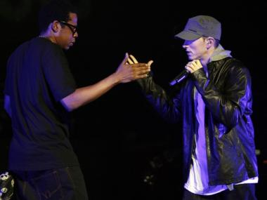 Eminem and Jay-Z perform together at a concert celebrating the launch of the video game