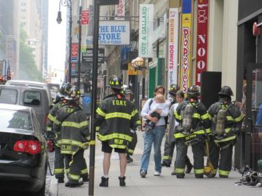 Firefighters evacuate West 40th Street after a manhole explosion May 3, 2010.