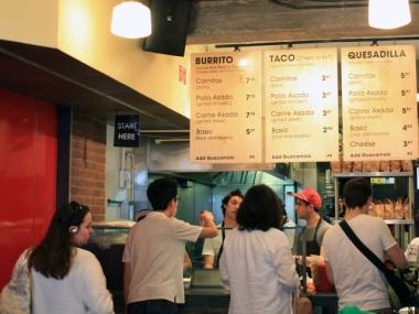 Customers line up to order at Dos Toros Taqueria in Union Square.