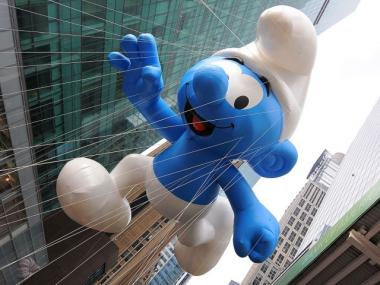 The Smurf balloon hovers over the crowd during the 83rd annual Macy's Thanksgiving Day parade on the Streets of Manhattan on November 26, 2009 in New York City.