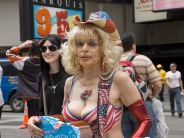 Naked Cowgirl Sandy Kane, 50, is accused of infringing upon the Naked Cowboy brand.