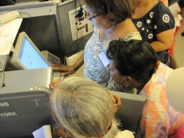 Voters test drive one of New York's new voting machines at a public demonstration of the new machines on the Upper West Side.