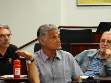 Paul Hovitz, center, argued Tuesday night that the board should rescind its support of the 13-story mosque and community center. Allan Tannenbaum, left, and Paul Sipos, right, agreed.