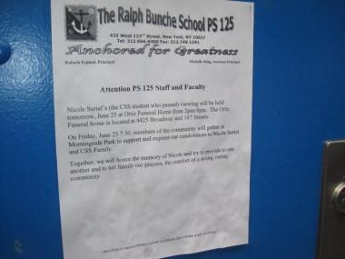 A sign on the school door with news of Nicole Suriel's memorial.