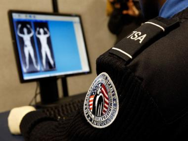 A TSA agent looks at an image of a full-body scan at Reagan National Airport in Arlington, Virginia.