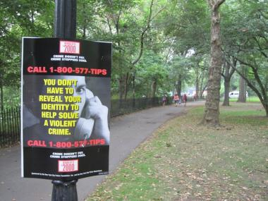 A Crime Stoppers poster in Riverside Park near the spot where a 19-year-old jogger was attacked and robbed in July 2010.
