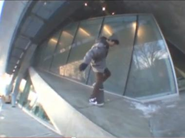 A skateboarder rides on the Cooper Union ramp.