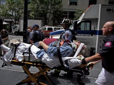 A Con Edison worker is rushed to the hospital after falling off a ladder below ground on Friday, July 9, 2010.