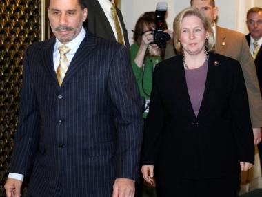 Gillibrand, with Gov. David Paterson, was noticeably heavier when she arrived at a news conference in January 2009.