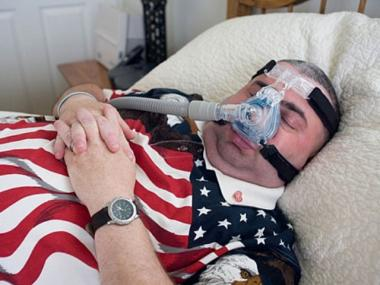 Former EMT Charles Giles, who has been diagnosed with 17 illnesses since 9/11, uses a CPAC machine to keep him breathing while he sleeps.