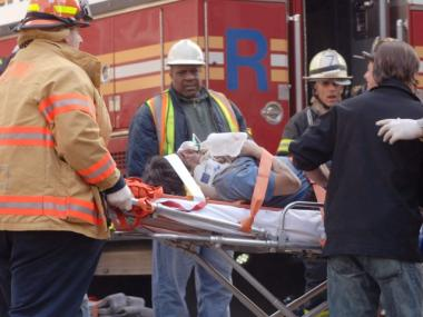 Rescue workers respond to the collapse of a high-rise crane under the operation of Rapetti Rigging Services in March 2008. Seven people were killed.