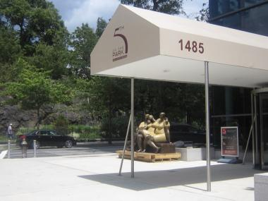 A new statue outside of the 5th on the Park condominiums has created controversy between the building's developers and long-time residents of the Harlem neighborhood.