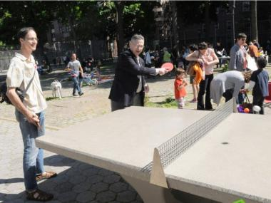 Assembly Speaker Sheldon Silver took a whack at the table in Gulick Park as Alan Good looked on.