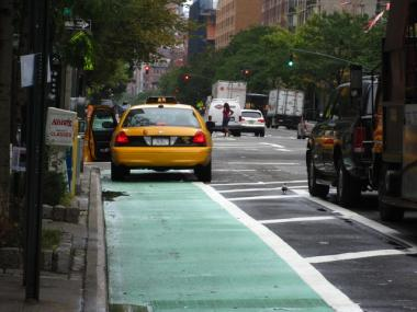 Cabs and bikes often face off mid-lane, one of many violations of bike lane rules discovered in a study by the Manhattan Borough President's office.