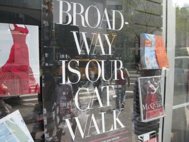 A poster produced by the Lincoln Square Business Improvement District beckons Fashion Week attendees to spend money in neighborhood businesses.