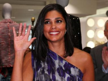 Designer Rachel Roy is scheduled to attend a Wednesday night panel discussion on fashion careers aimed at young people who live in public housing.