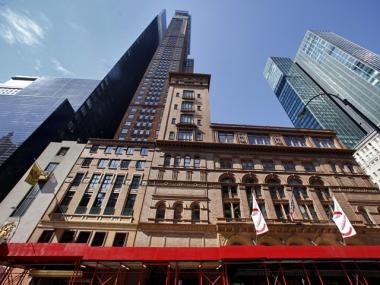Construction moves forward on the Carnegie Hall studio towers after the last remaining tenants agree to leave the building.