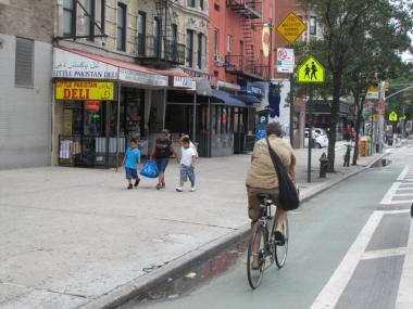 A cyclist rode north on the First Avenue bike lane, which runs along the west side of the street.