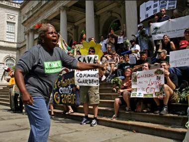 New York City Community Garden Coalition President Karen Washington fires up the crowd in front of City Hall.