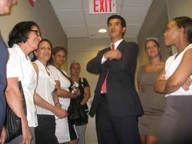 Ydanis Rodriguez stands with supporters before the Committee announced its decision.