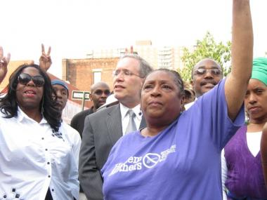 Among those who rallied at the scene of the fatal police shooting in Harlem were Jackie Rowe Adams, of Harlem Mothers SAVE, foreground, and, behind her, Manhattan Borough President Scott Stringer.